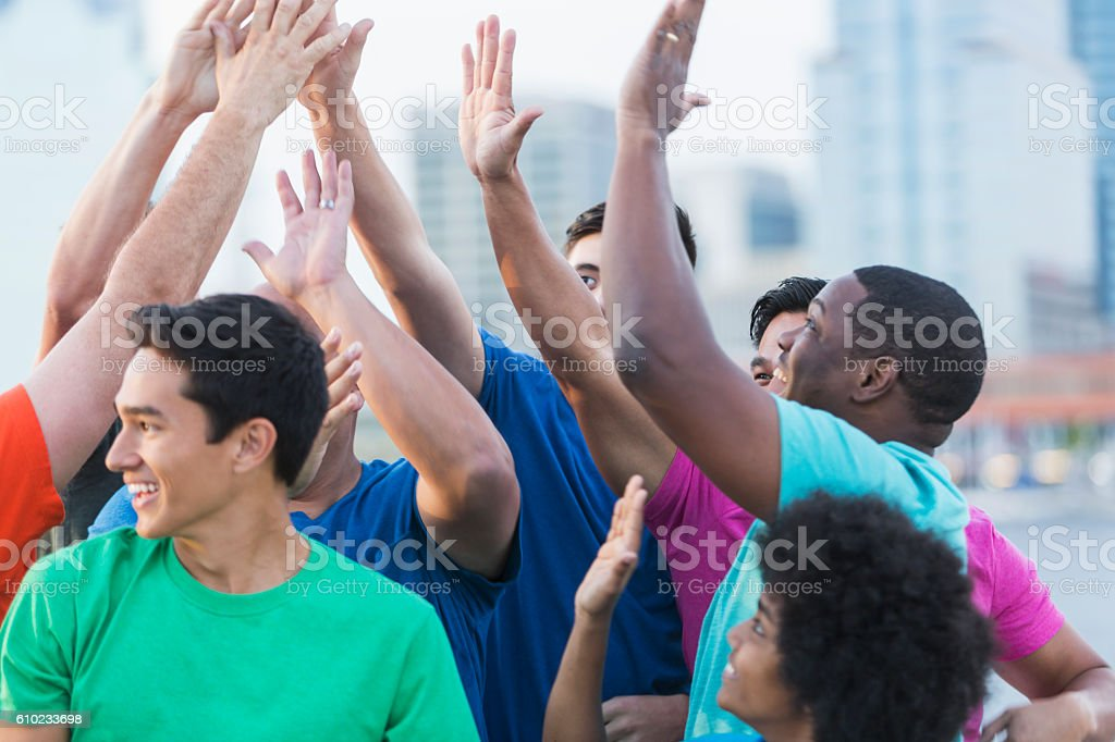 Multi-ethnic group of fathers and sons, high-five stock photo
