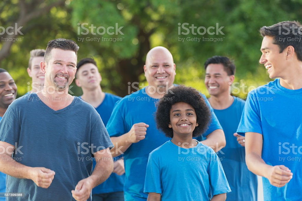 Multi-ethnic group of fathers and sons walking together stock photo
