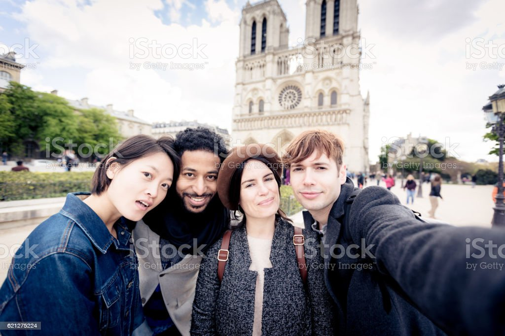 Multi-ethnic group of friends having fun in Paris, Notre Dame stock photo