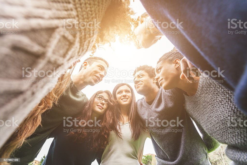 Multiethnic Group of Friends in a Circle stock photo