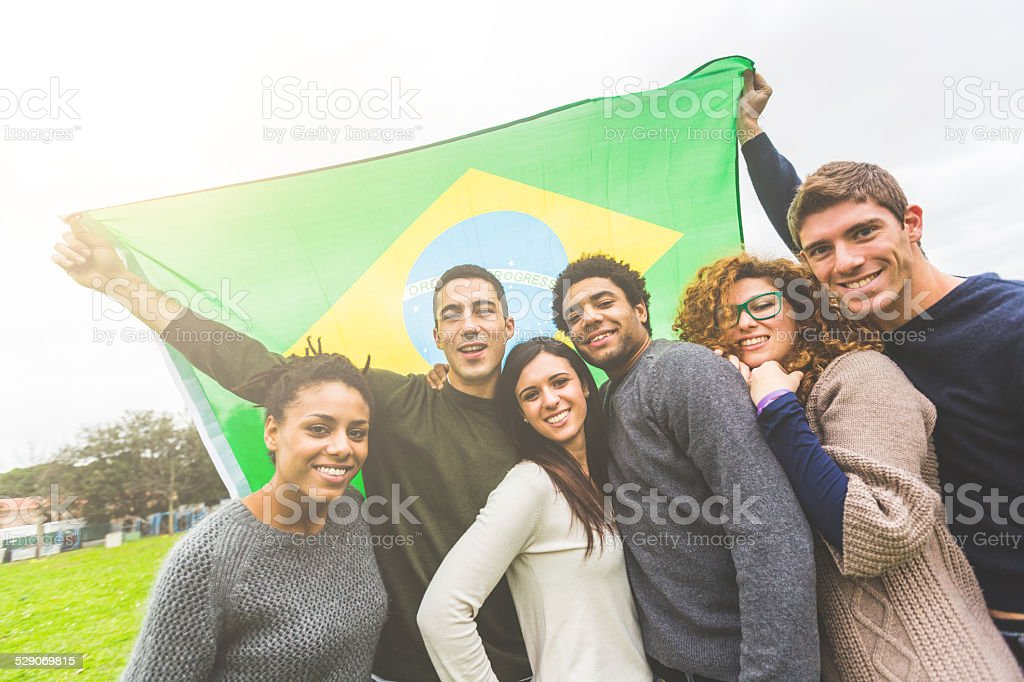 Multiethnic Group of Friends with Brazilian Flag stock photo