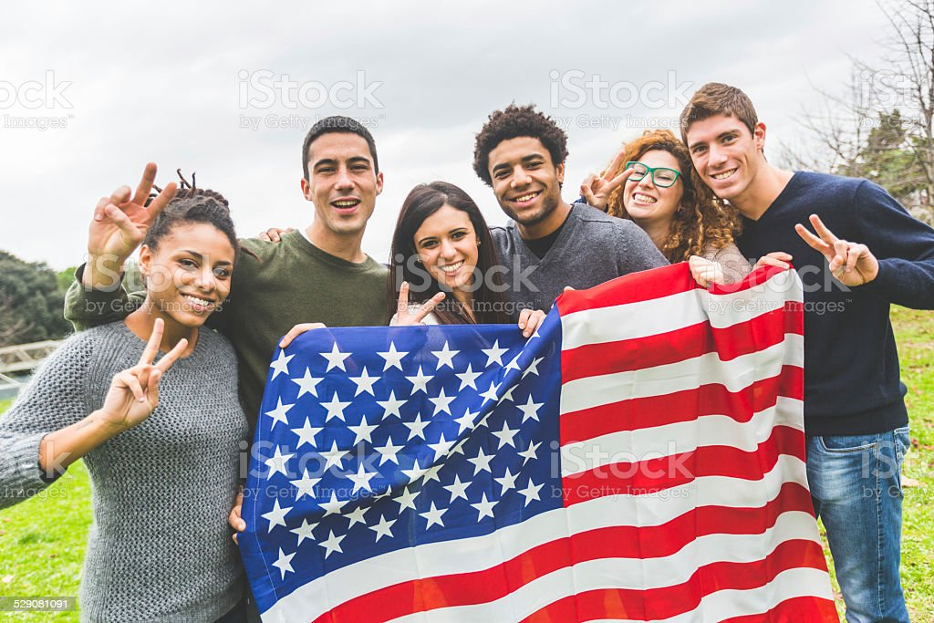 Multiethnic Group of Friends with United States Flag stock photo