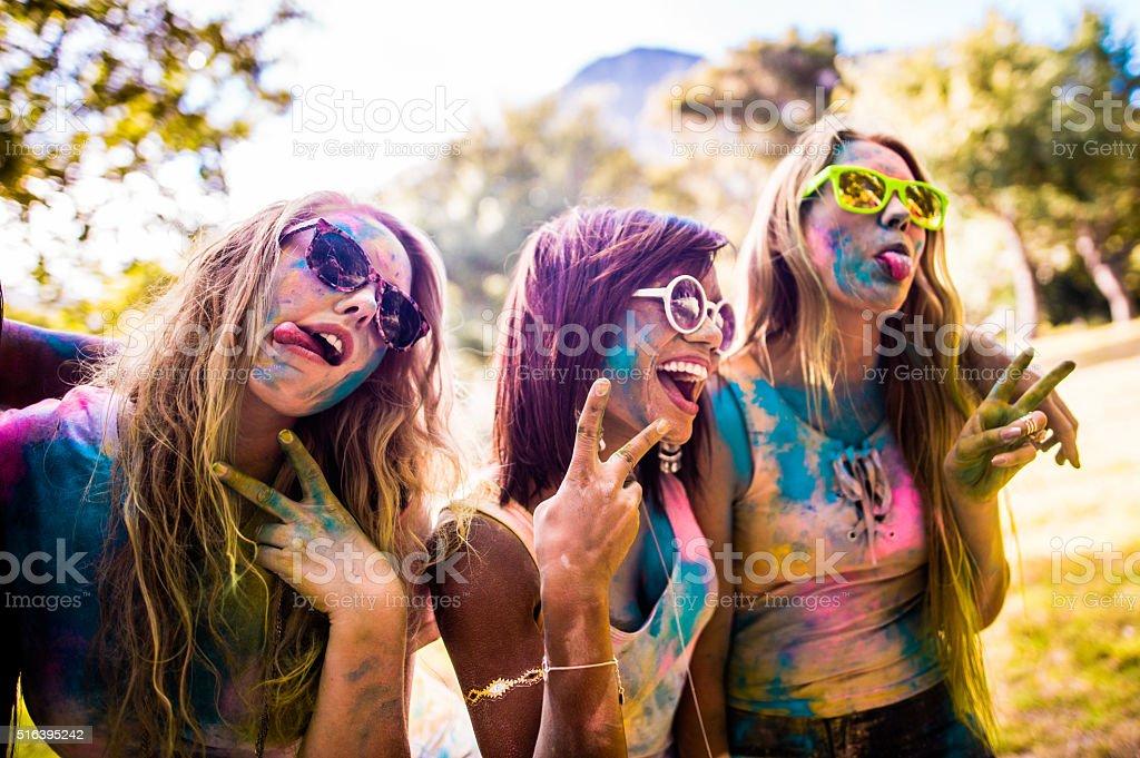 Multi-Ethnic Group of Girls Celebrating Holi Festival stock photo