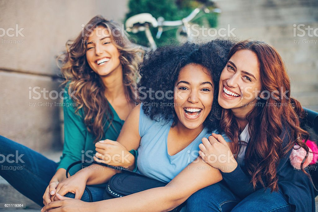 Multi-ethnic group of girls laughing stock photo