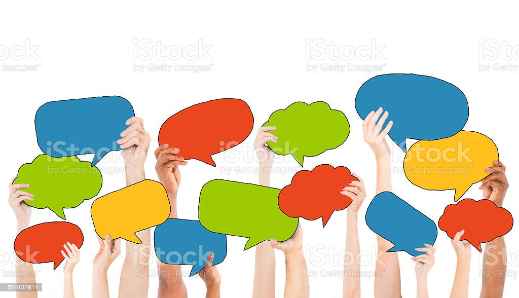 Multiethnic Group of Hands Holding Speech Bubbles stock photo