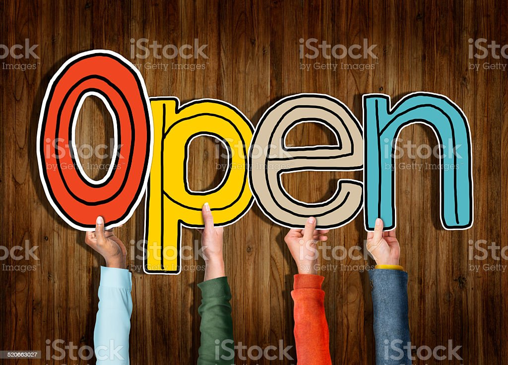 Multiethnic Group of Hands Holding Word Open stock photo