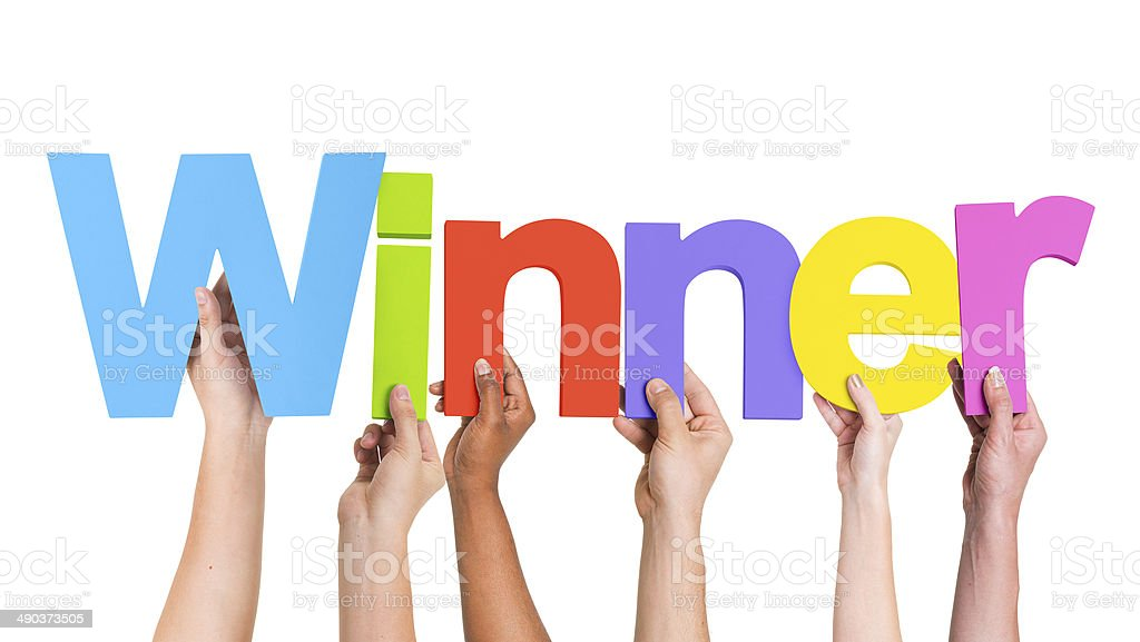 Multiethnic Group of Hands Holding Word Winner stock photo