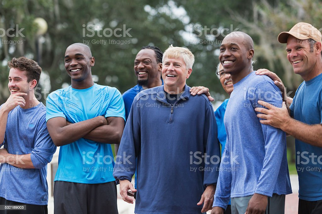 Multi-ethnic group of men standing outdoors stock photo