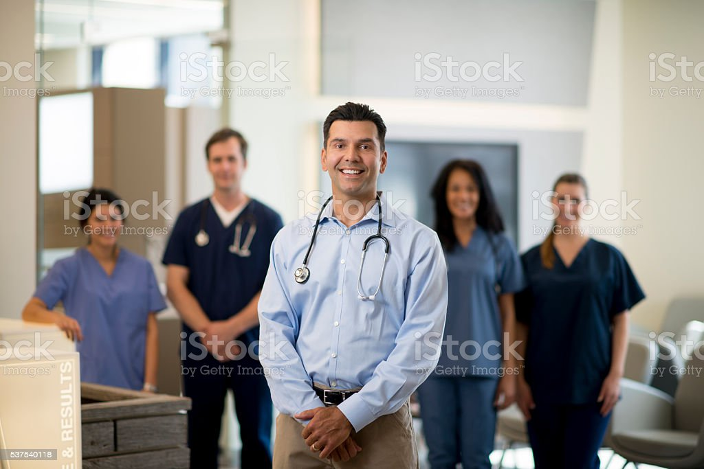 A multi-ethnic group of nurses and doctors are standing stock photo