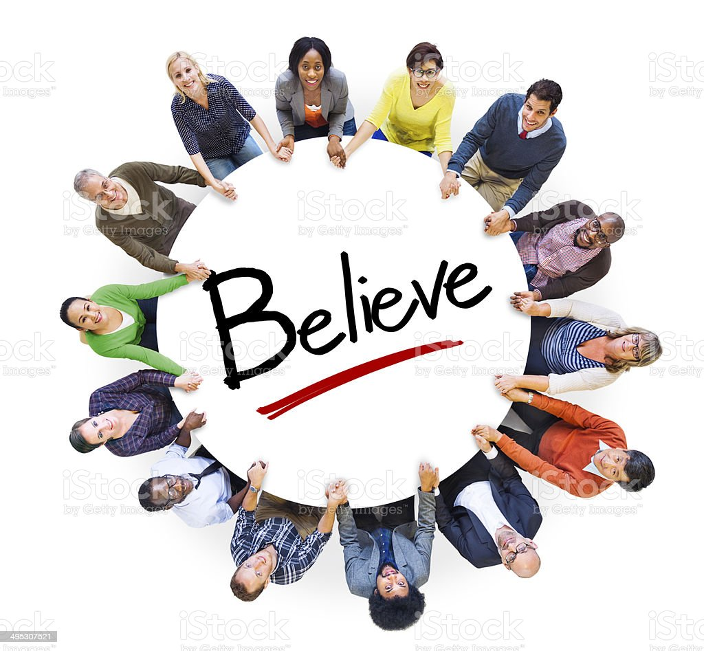 Multiethnic Group of People Holding Hands and Belief Concept stock photo
