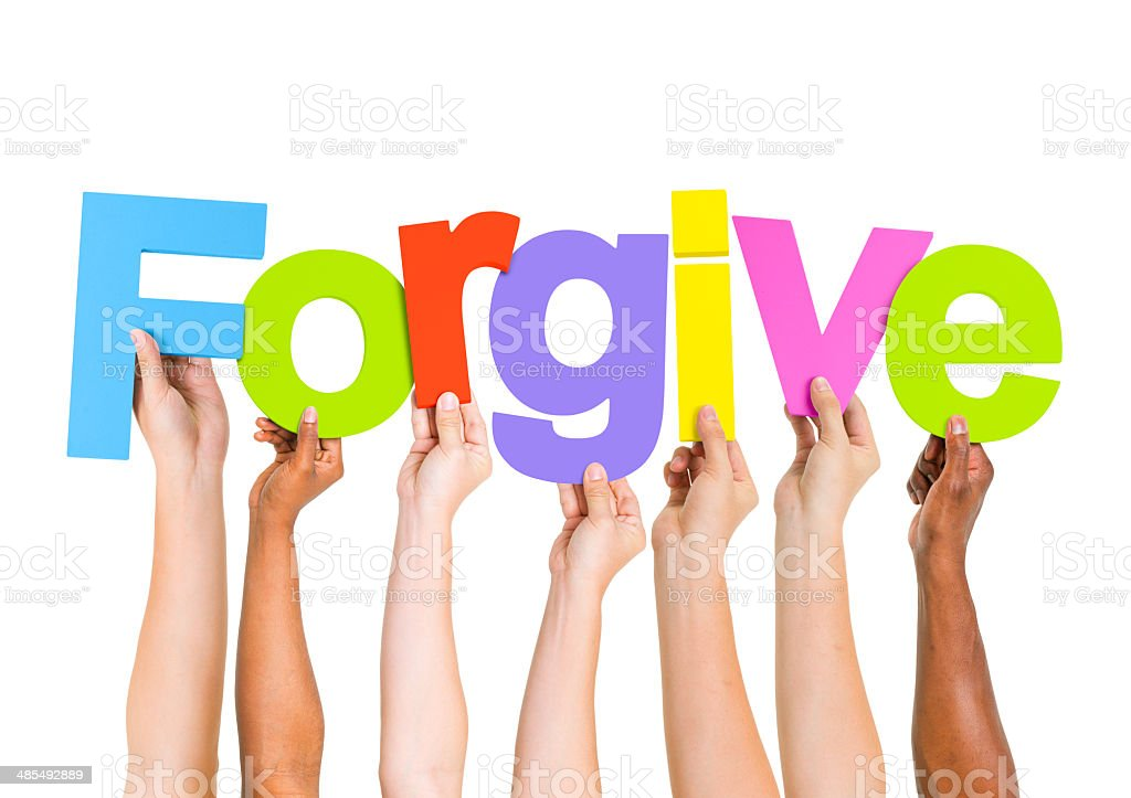 Multi-Ethnic Group of People Holding Letters To Form A Forgive stock photo