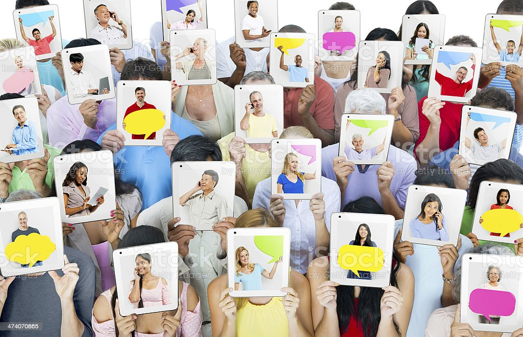 Multi-ethnic group of people holding tablets in front of the faces stock photo
