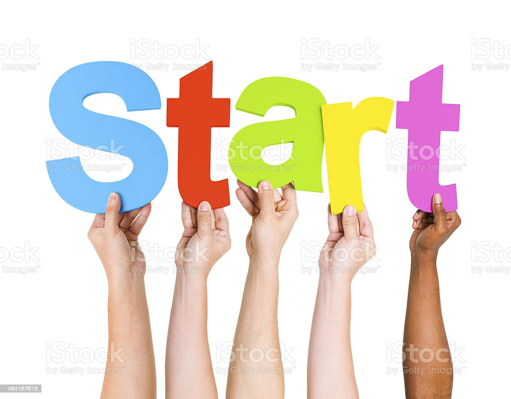 Multi-Ethnic Group Of People Holding The Word Start stock photo