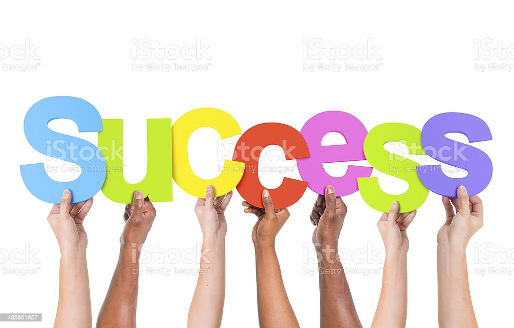 Multi-Ethnic Group Of People Holding The Word Success stock photo