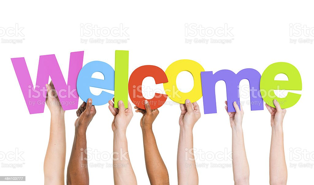 Multi-Ethnic Group Of People Holding The Word Welcome stock photo