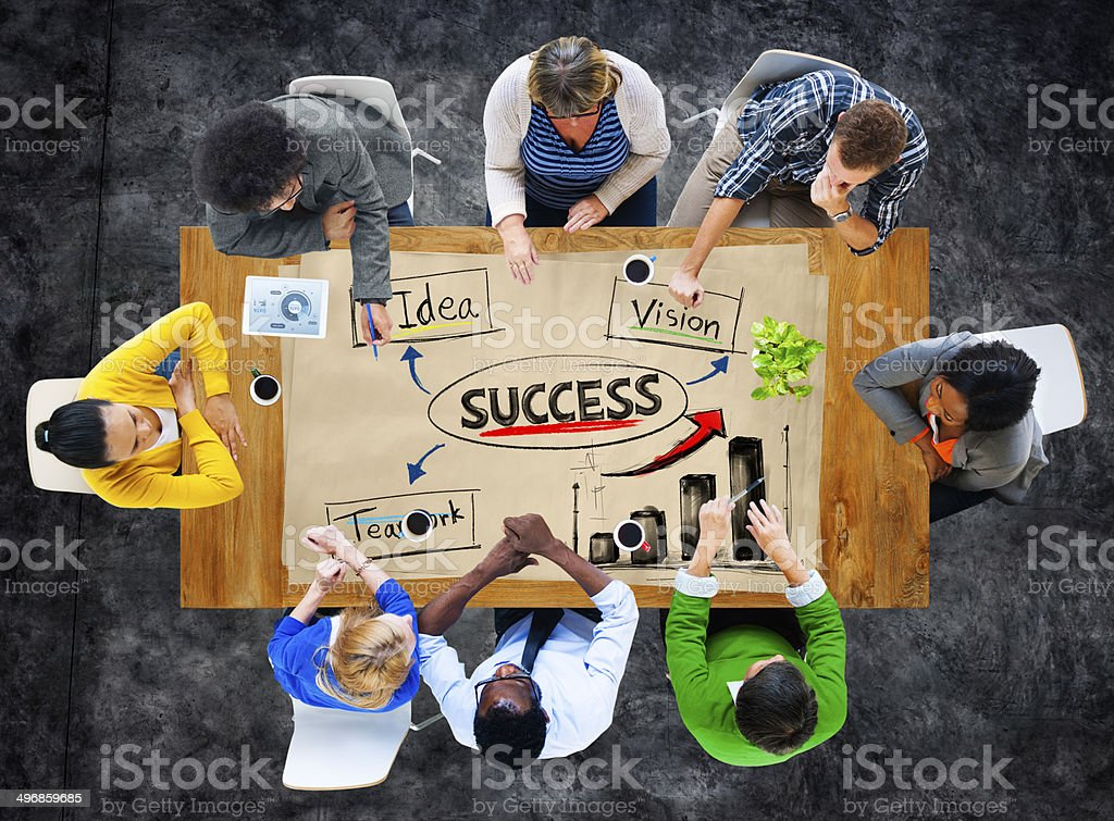 Multiethnic Group of People in a Meeting and Success Concepts stock photo