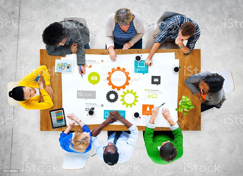 Multiethnic Group of People Meeting with Gear Symbol stock photo