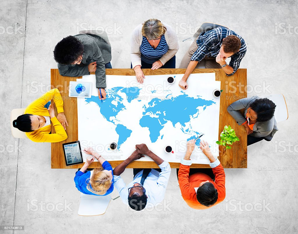 Multiethnic Group of People Meeting with World Map stock photo