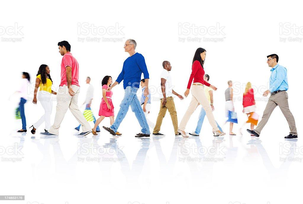 Multi-ethnic group of people walking royalty-free stock photo