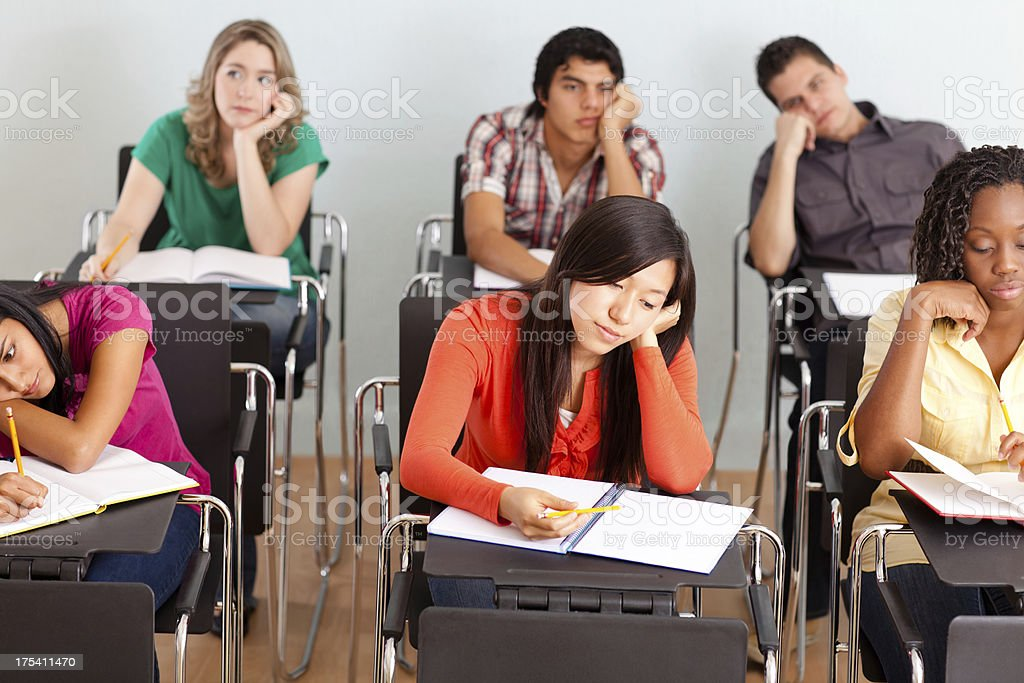 Multi-ethnic group of students bored during class royalty-free stock photo