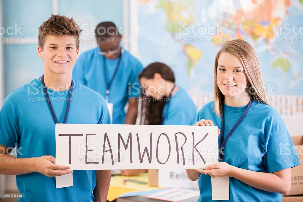 Multi-ethnic group of teenagers organize global donation event. stock photo