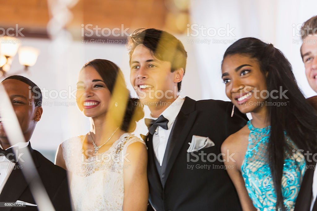 Multi-ethnic group of teens at prom stock photo