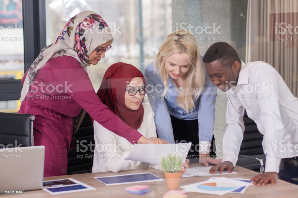 Multiethnic group of young business persons at office stock photo