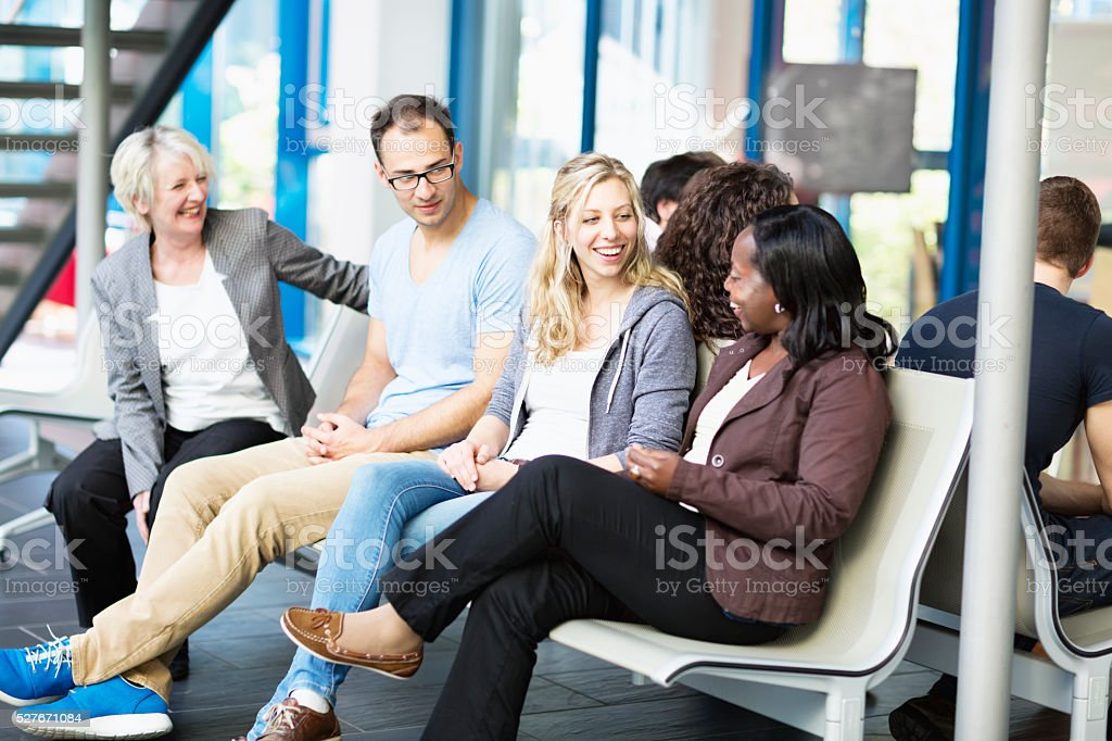 Multi-ethnic group talking and laughing friendship togetherness stock photo