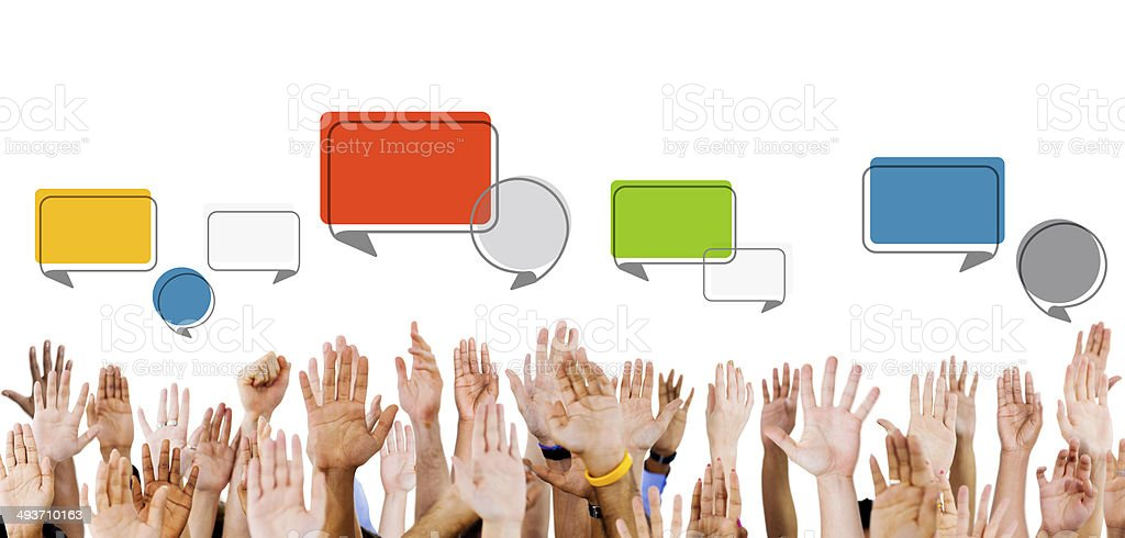Multiethnic Hands Raised with Speech Bubbles stock photo