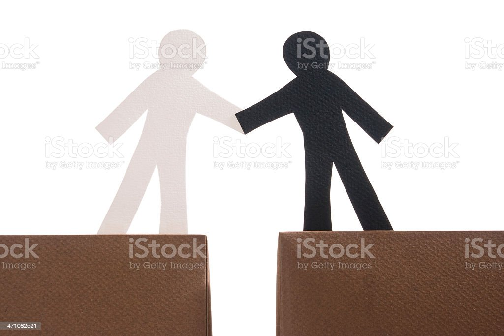 Multi-ethnic handshake royalty-free stock photo
