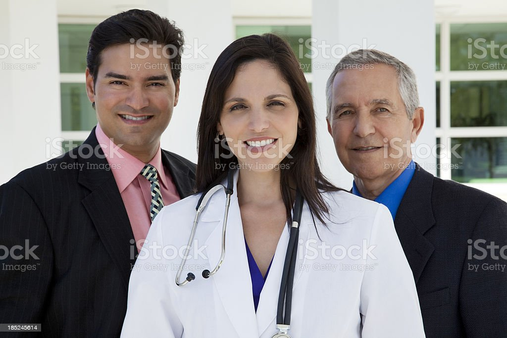 Multi-ethnic hospital medical staff in front workplace stock photo