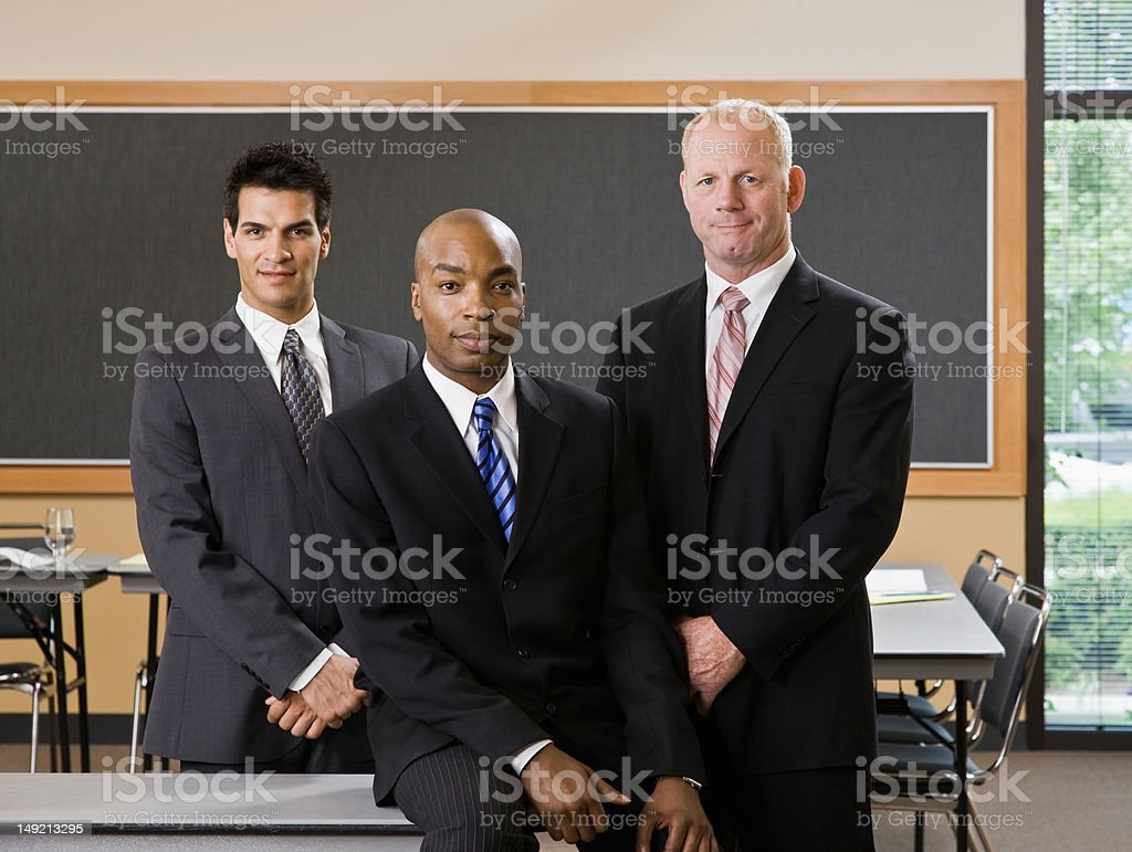 Multi-ethnic male co-workers posing in conference room royalty-free stock photo