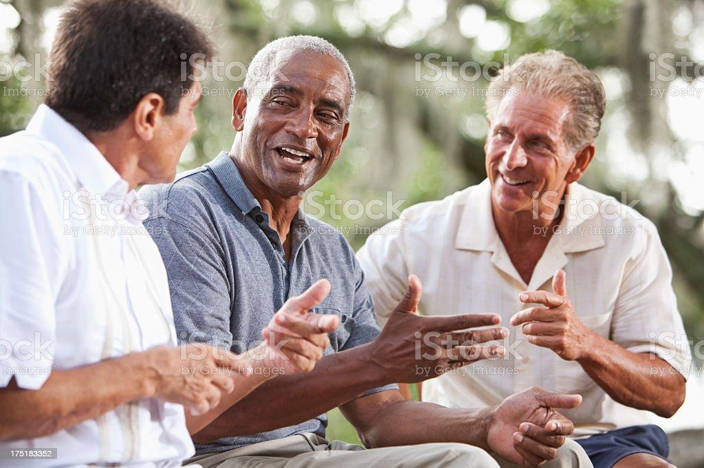 Multi-ethnic men talking royalty-free stock photo