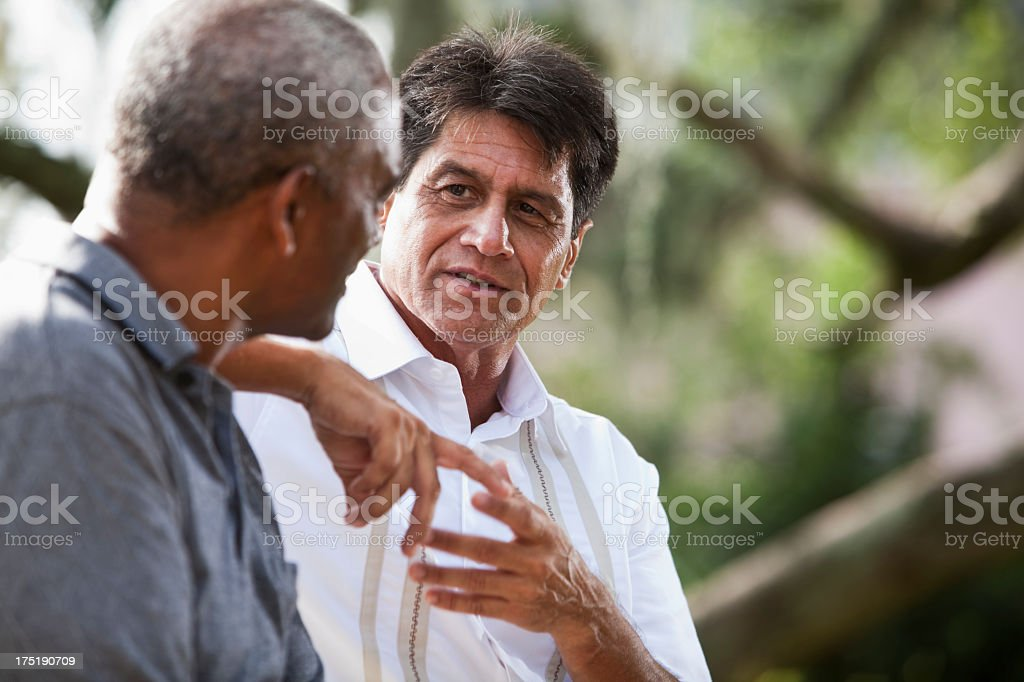 Multi-ethnic men talking stock photo