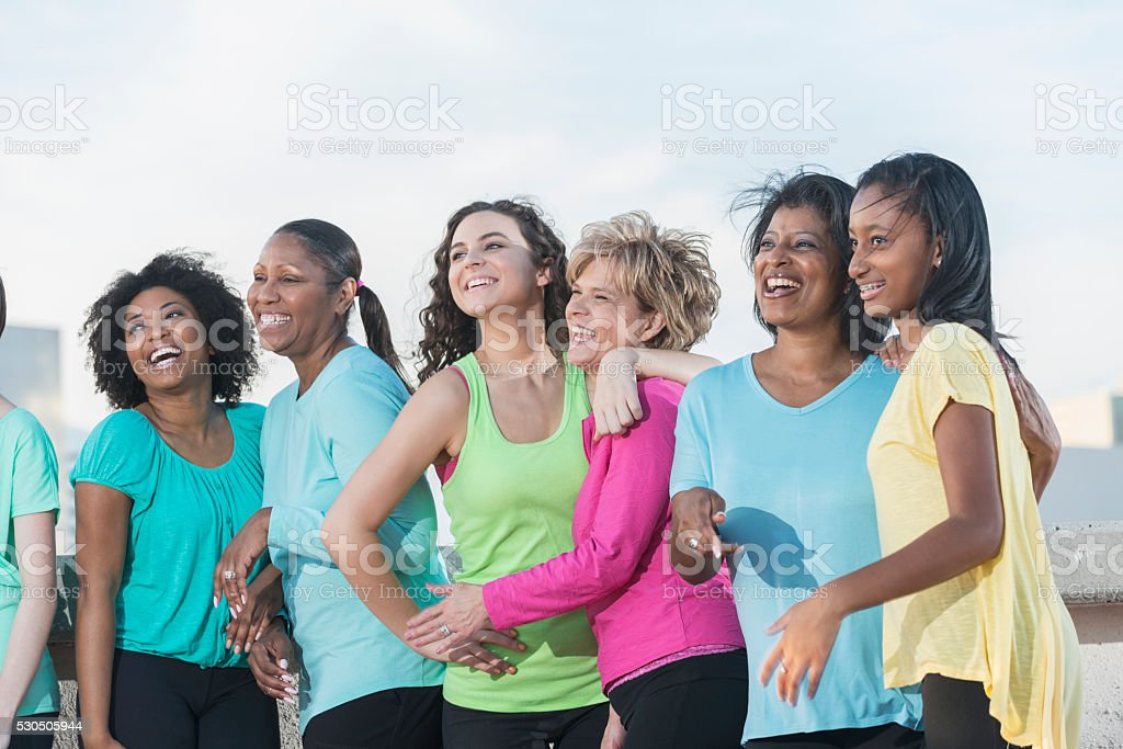Multi-ethnic mothers and daughters on waterfront stock photo