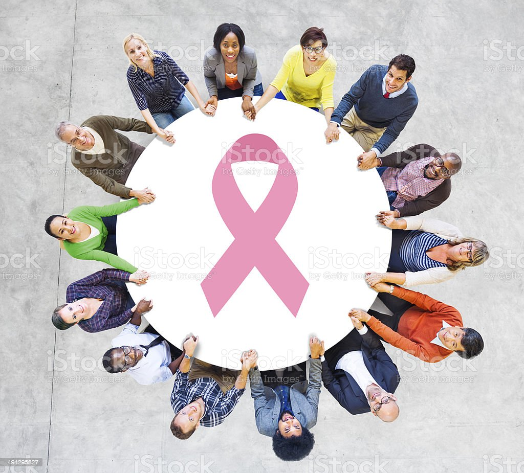 Multiethnic People Holding Hands for Breast Cancer Foundation stock photo