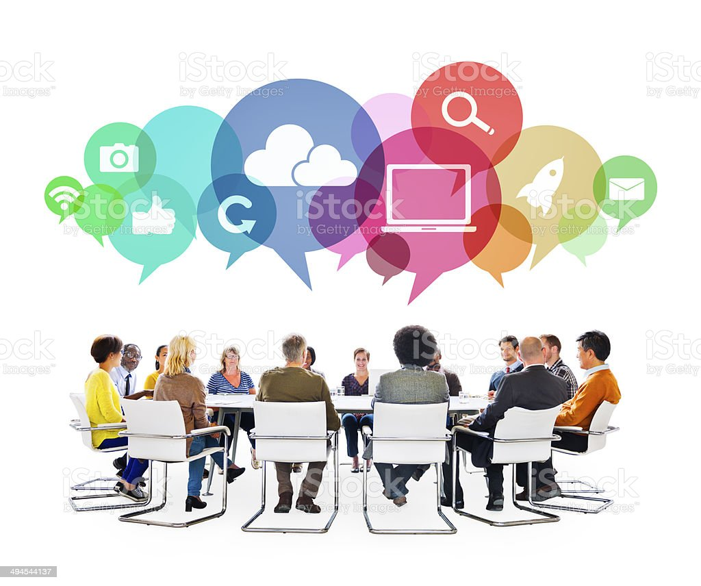 Multiethnic People in a Meeting with Social Media Symbols stock photo