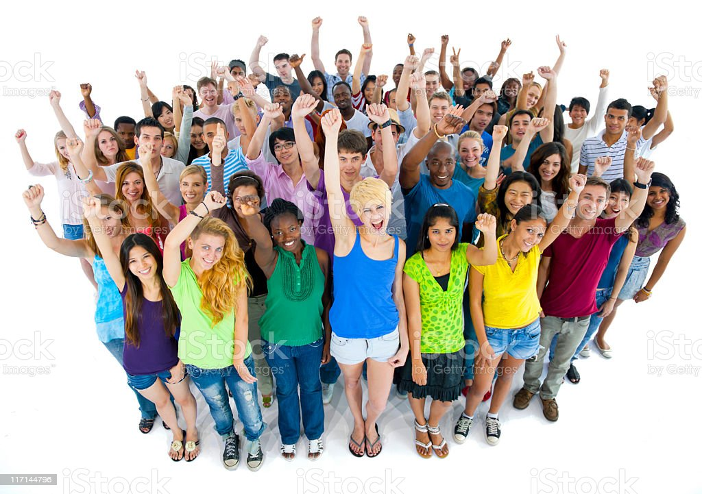 Multi-ethnic people with their hands up celebrating royalty-free stock photo