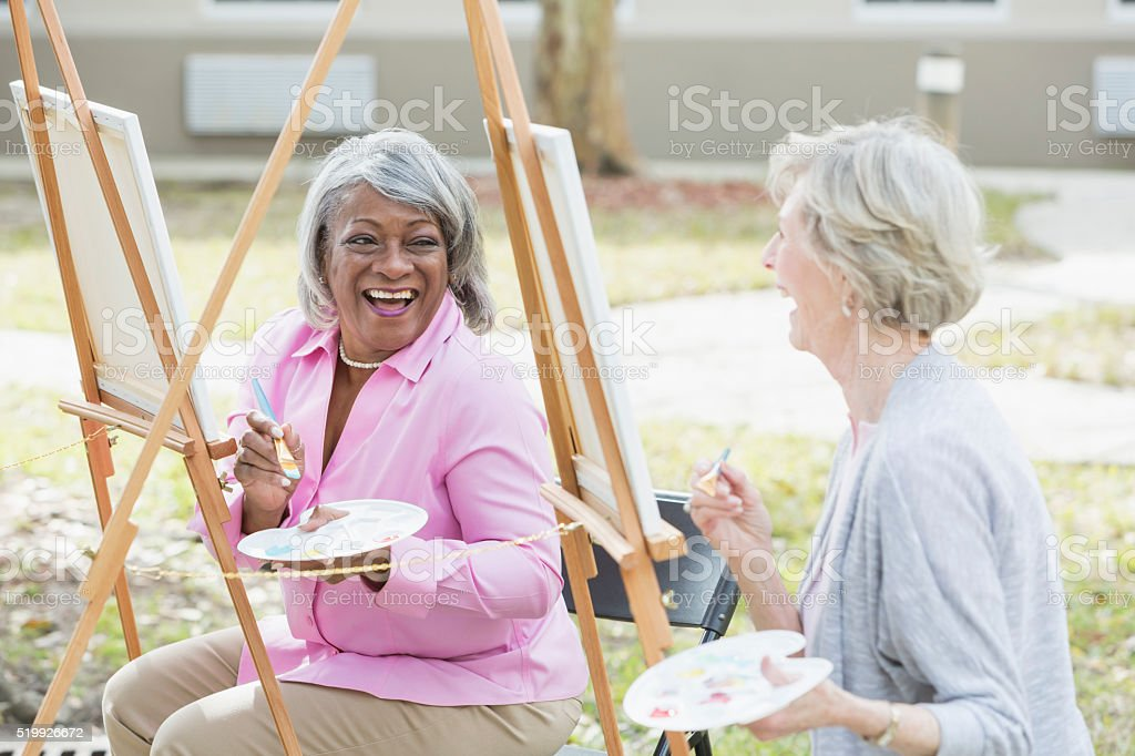 Multi-ethnic senior women taking an art class stock photo