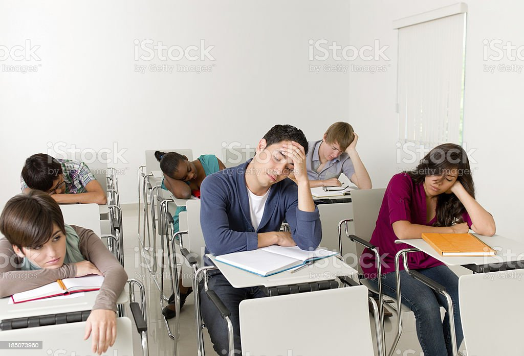 Multi-ethnic students bored during class royalty-free stock photo