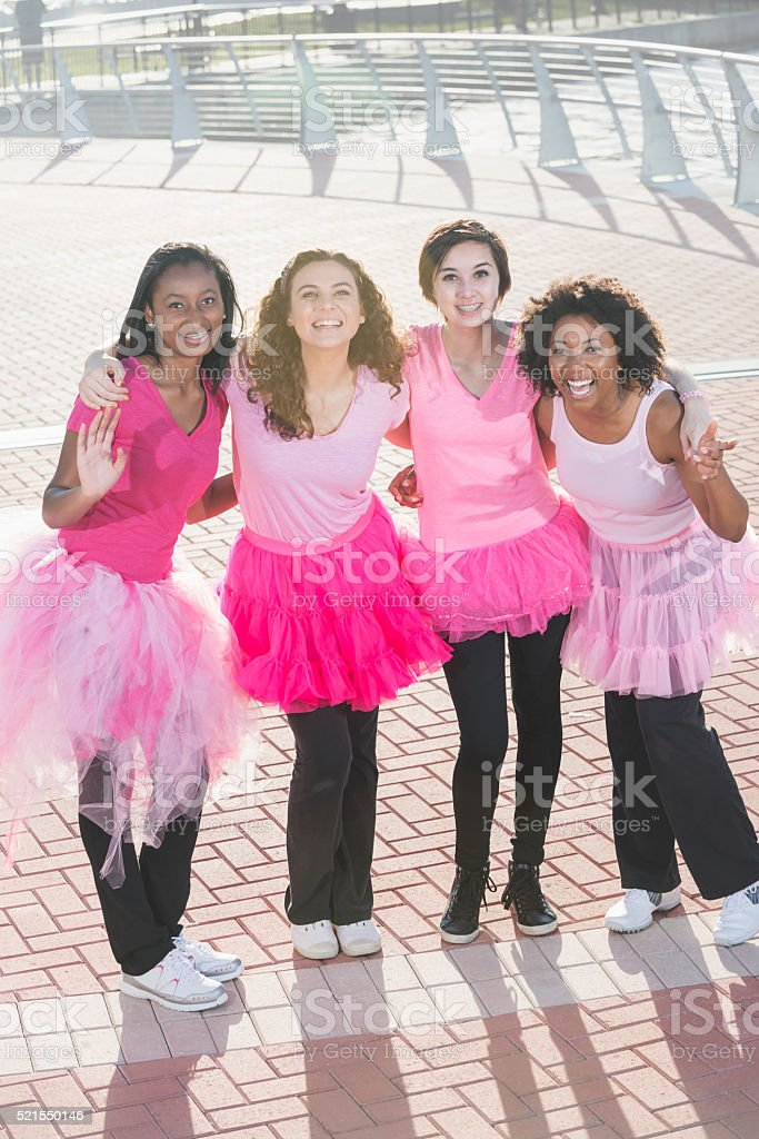 Multi-ethnic teenage girls and young women in pink stock photo