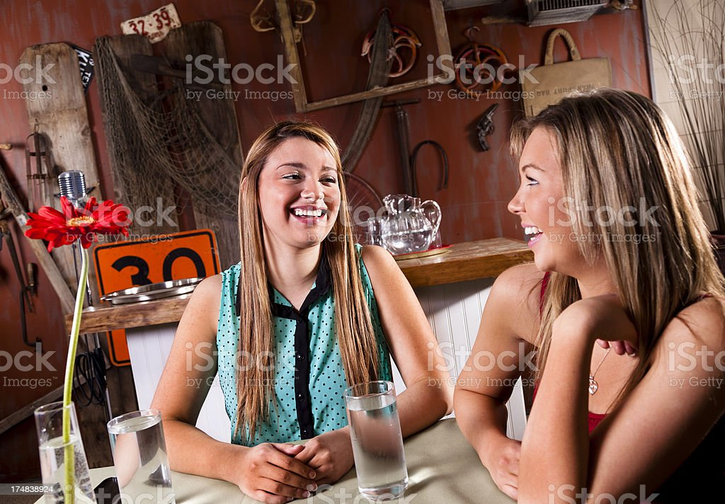 Multi-ethnic women dining at a rustic country restaurant royalty-free stock photo