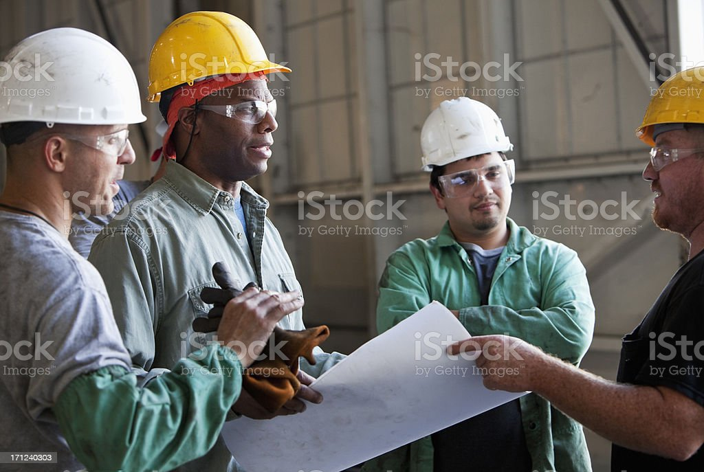 Multi-ethnic workers discussing plans. royalty-free stock photo