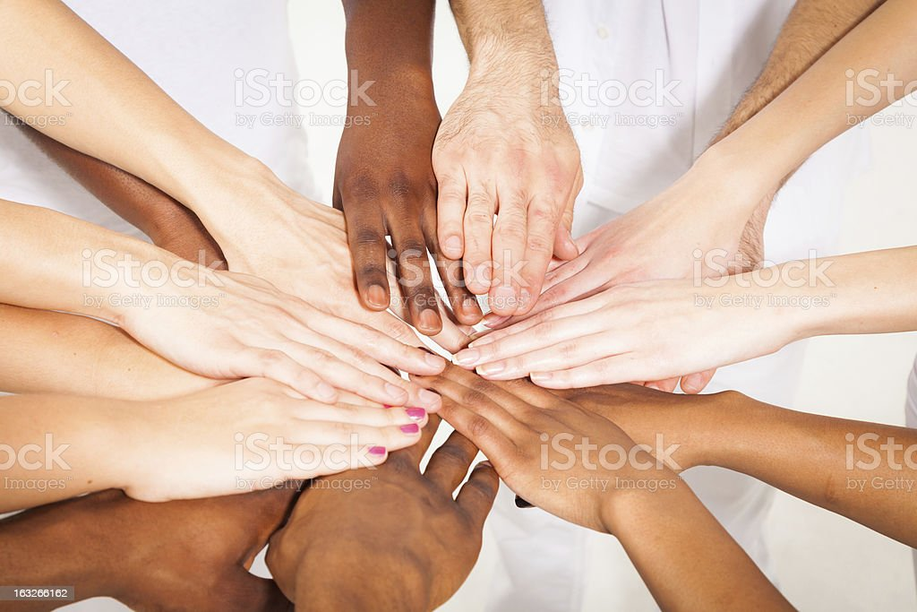 multi-ethnic young adults' hands stock photo