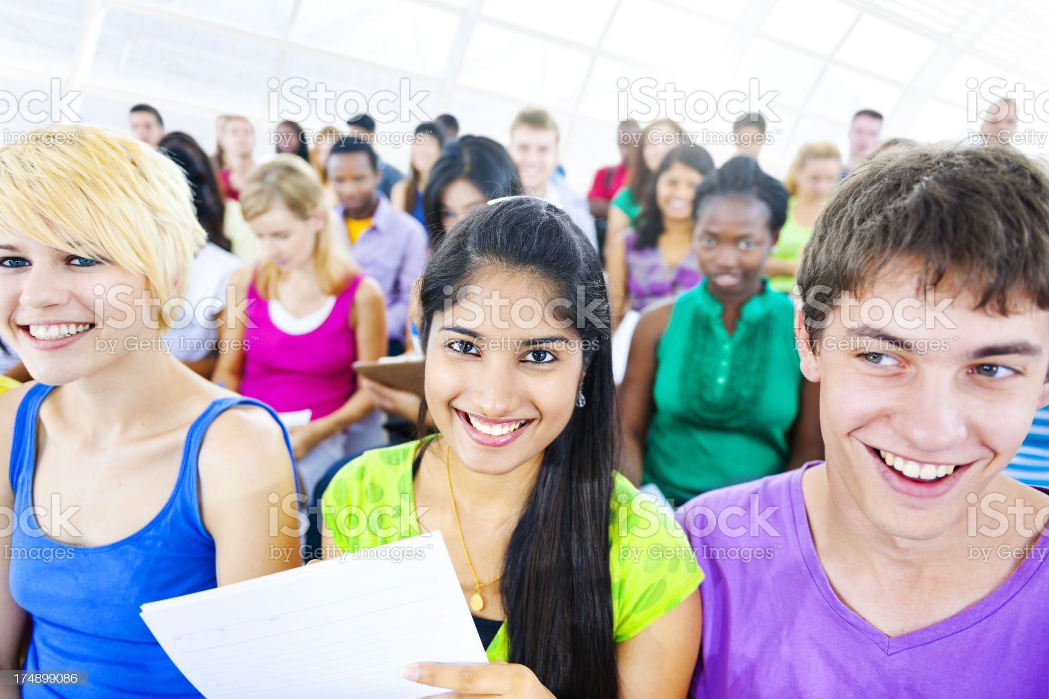 Multi-ethnic young people in lecture room royalty-free stock photo