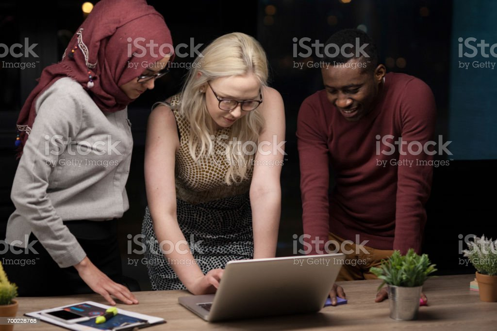 Multiethnic young team of business persons on meeting in office stock photo