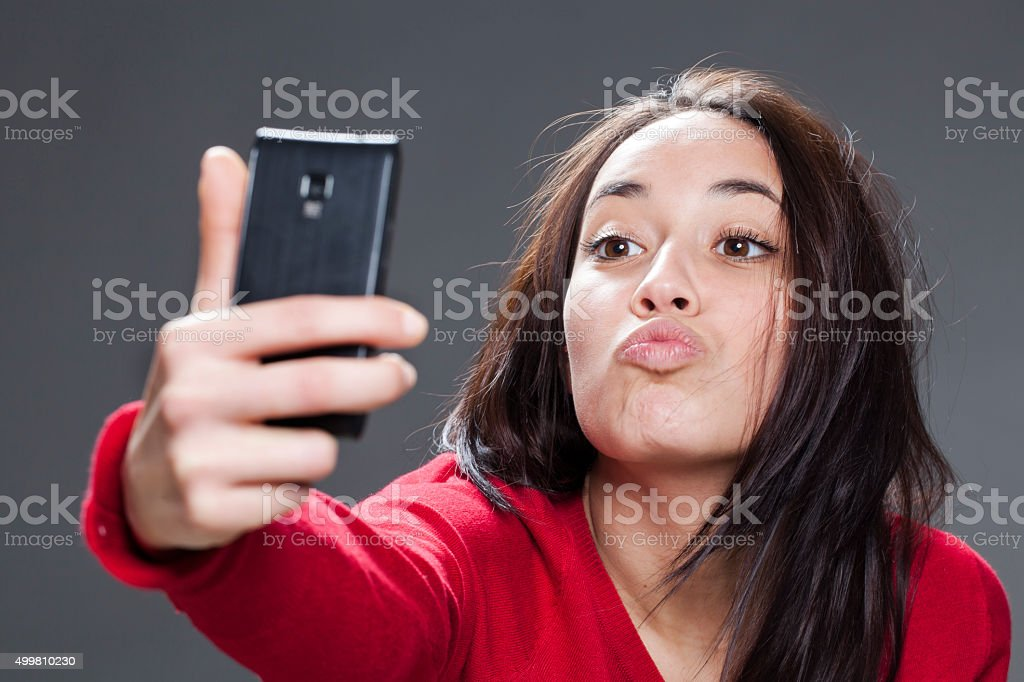 multiethnic young woman's pout for selfie stock photo