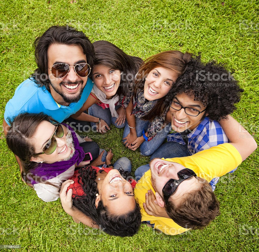 Multi-ethnics group of young students having fun at university campus royalty-free stock photo