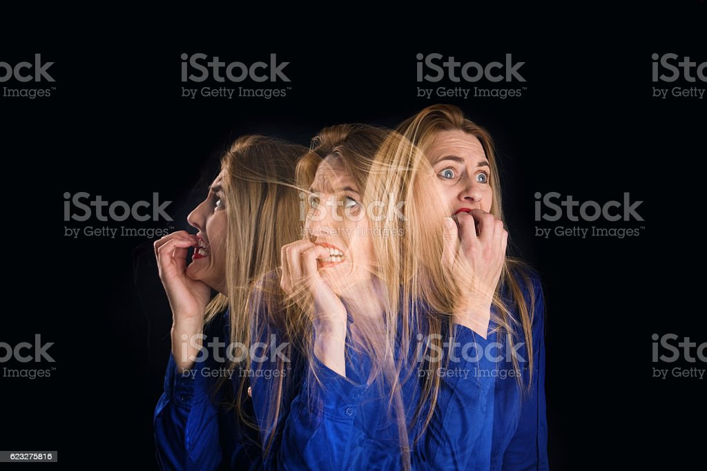 Multi-Exposure Nervous Woman stock photo