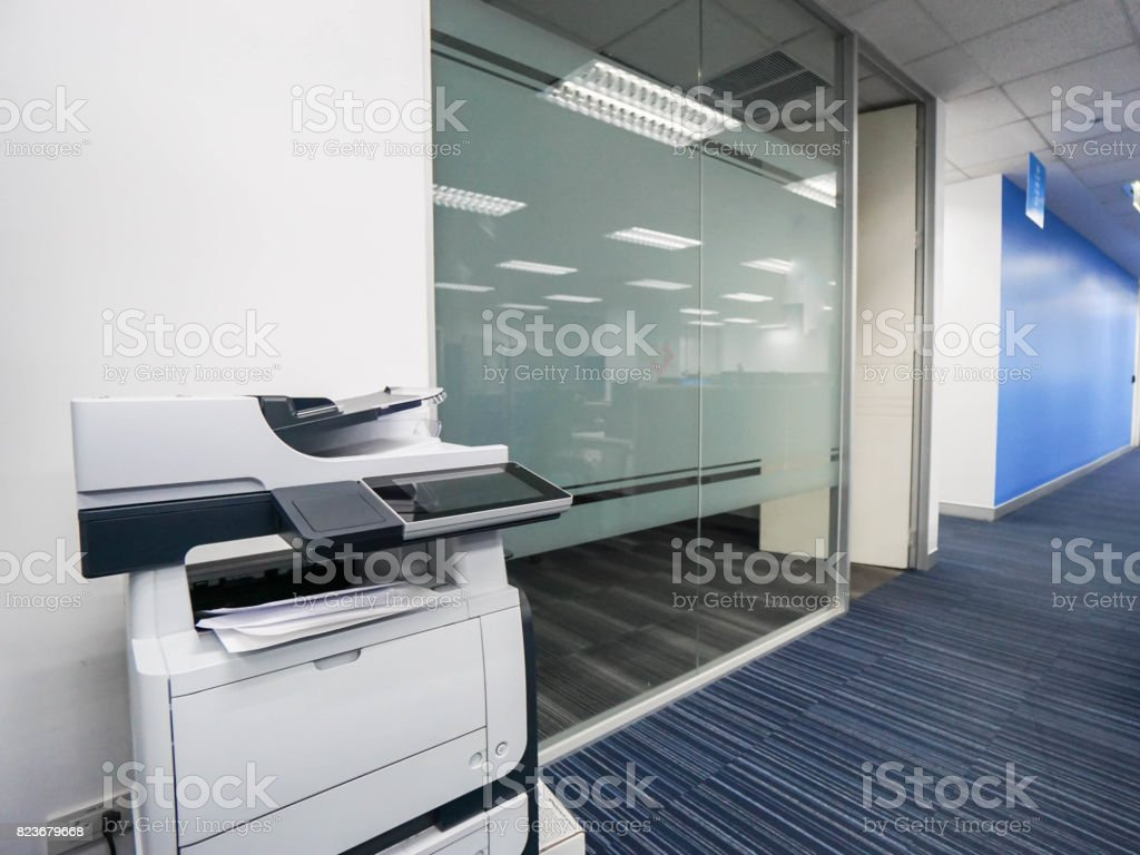 multi-function printer machine ready for printing, copy, scanning business documents in office stock photo